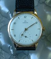 Omega 18k gold 36mm manual cal 265 c1947